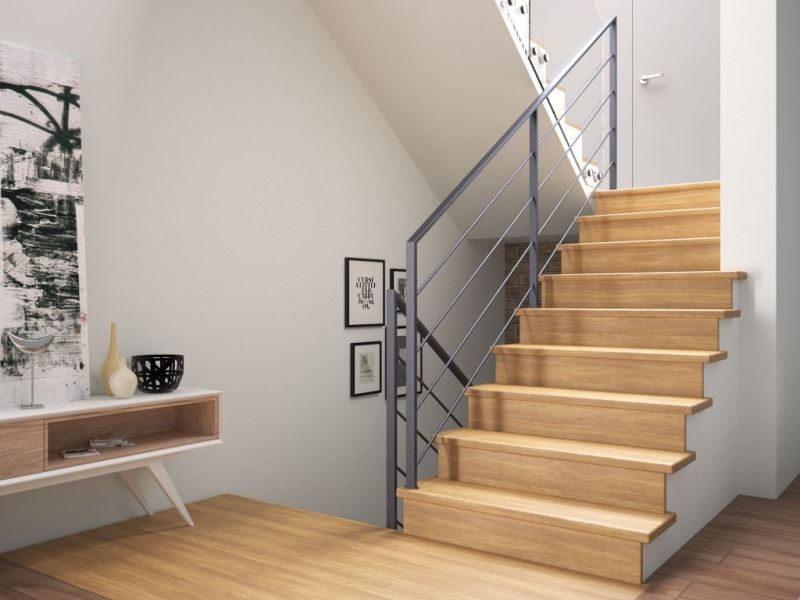 Obłożenie schodów betonowych drewnem dębowym, z ciemnoszarą poręczą Weld wykonaną z profili stalowych (cena ok. 13 tys. zł brutto w ramach promocji obowiązującej w lutym 2017 r.).Fot. Rintal Polska